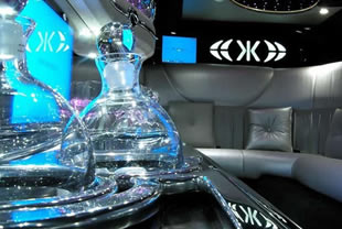 Decanters and mood lighting inside limousine