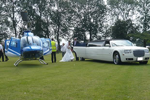 Bride steps from helicopter into wedding limousine